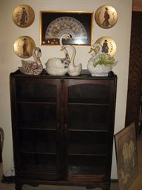 Swans and vintage glass front cabinet
