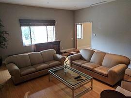 "Custom Channel Designed Silk Sofas •Two custom designed Channel silk sofas •Upholstered in pale gold natural silk •Each sofa measures 94"" long with deep 24"" seats"