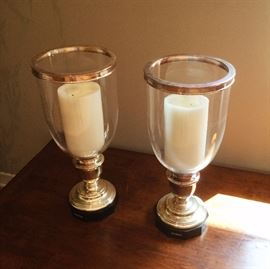 """Ralph Lauren Hurricane Lamps •Two (2) Ralph Lauren Hurricane Lamps •Sterling silver pedestal on black onyx base with silver top rim. •Each lamp measures 24"""" high by 10.5"""" in diameter"""