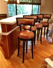 """Contemporary leather and wood bar stools (4) with swivel seats. Measures 36"""" H to Seat by 19"""" Seat diameter."""