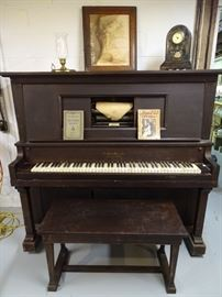 Player piano & bench (one of two player pianos for sale).  This one needs to be restored.