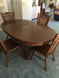 """(Tell City Oak) Dining room table with 4 chairs and pads (cane backing on chairs)     Approx 44"""" width   85"""" length   29"""" height"""