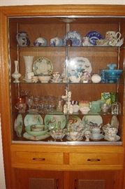 Art glass, china & collectibles in cabinet.