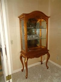 gold curio, lighted