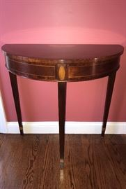 Baker Furniture - demi- lune with marquetry detail.
