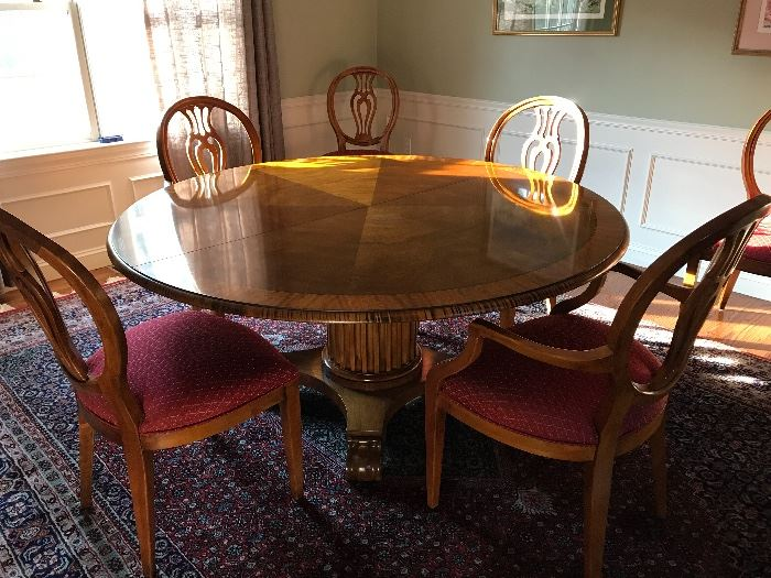 "Henredon Round Dining Table with one leaf, pads, two Natchez Collection arm chairs and 6 Natchez Collection dining chairs.  American made -- the fluted column pedestal and scrolled feet have classical motifs.  Measurements are 5' 4"" diameter and 30"" tall."