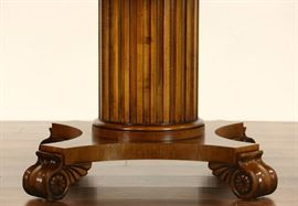 Fluted column pedestal and scrolled feet have classical motifs.