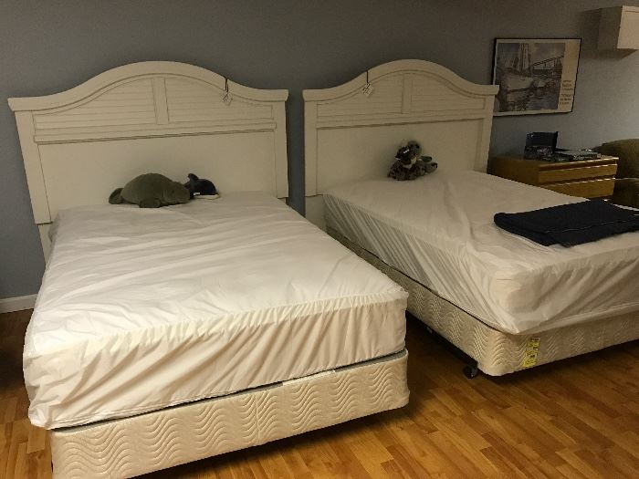 Ashley Furniture Double/Queen beds, can be either.
