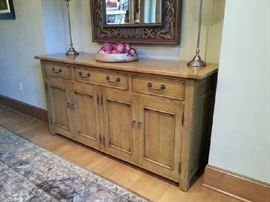 "close up of sideboard from Bausman with three drawers and four doors it measures 20""d x 68""w x 34""h"