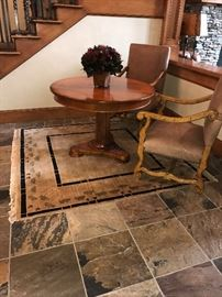 Baker Milling Road Table, Pande Cameron rug and Maitland and Smith armchairs