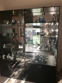 Vintage black display cabinet with collectibles