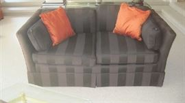 Chocolate  upholstered love seat/ silk pillows