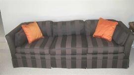 Chocolate upholstered sofa/  silk pillows