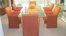 """Large glass top extended dining table- By Design Institute American, Inc. - 8'8"""" when extended ; 4'4"""" when not extended"""