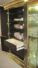 Three shelves and drawers inside the large mirrored doors