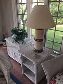 White rattan side tables, lamp and plants