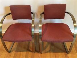 Pair Breuton stainless with brass finish, cantilevered arm chairs