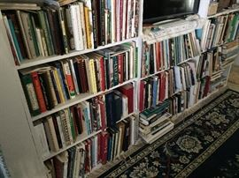 Large book collection, including cookbooks
