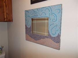 Beveled mosaic mirror.