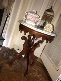 Victorian marble top table.  China and painted lamp