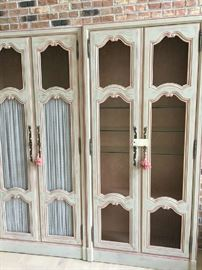 """2 lighted Curio / Armoire's done in Salmon/Beige/ Gray tones with Chicken wire front, draperies velcro in, Shelves inside...80""""h 37""""w 12""""d"""