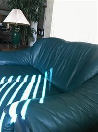 Green leather sofa and love seat