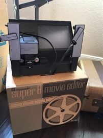 COOL RETRO MOVIE EDITOR.  We also have a pull down stand up screen for viewing.