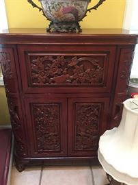 Exquisite hand carved bar that opens up with glass holders and full bar capabilities..one of a kind!