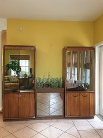Wonderful display cabinets..mirrored and has a matching credenza