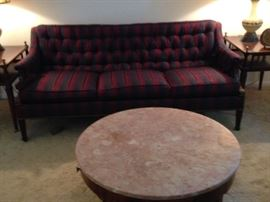 Couch was recently reupholstered; round marble top coffee table.