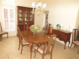 Thomasville Cherry Dining room table and 10 chairs, china cabinet and server