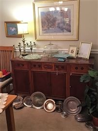 Buffet, silver plate serving pieces, and cake stands