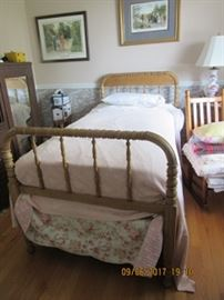 Maple twin bed.  Print on wall is of colonial family and the one on the left is a Southern family.