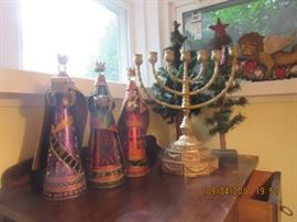 Three wise men with jeweled robes, the Menorahm and two Christmas trees are in the back.