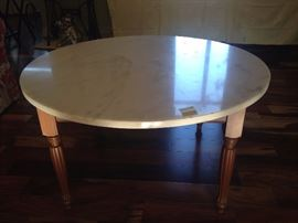 Solid marble top table with wooden legs.
