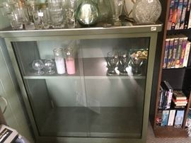 Wow! A retro metal display cabinet with sliding glass doors -- nice vintage drinking glasses/decanters and more.