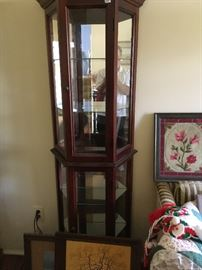 This is the same style Pulaski curio cabinet in walnut -- both are in excellent condition.