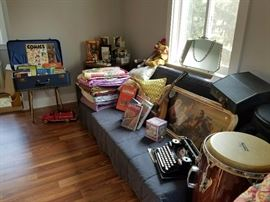 Vintage luggage, blankets, quilts picture, old typewriter in case with manual, Mattel Disney dolls (NEW in box) and Drum with carrying bag