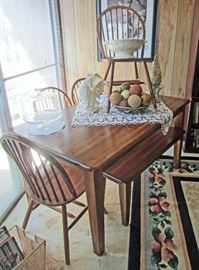 Wood dinette table with four chairs and bench (seats 6)