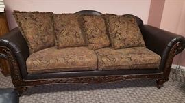 mix media sofa of leather, wood upholstery