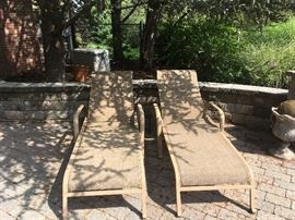 2  outdoor lounge chairs, with wheels. $50.00