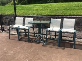 Tall table, with 4 chairs, $50.00