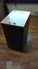 Filing cabniet. Too lifts up bottom drawer opens and locks with key.