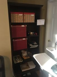 Bookshelf with storage boxes and office supplies