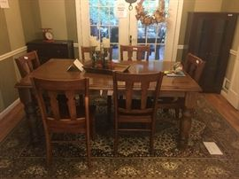 Casual dining room table with 6-chairs, area rug, hutch with glass doors, grain scale