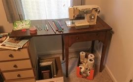 Dressmaker sewing machine and cabinet