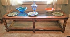 coffee table with glass top and cane bottom