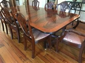 "Henkel Harris double pedestal mahogany dining table, 2 24"" leaves,  with 8 antique mahogany Sheraton dining chairs with fleur de Lis  backs"