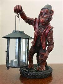An Organ Grinder's Monkey Lights The Way