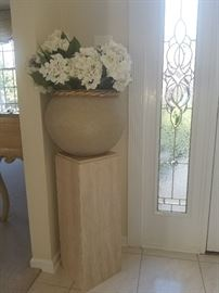 gorgeous pedestal and ceramic pot of flowers